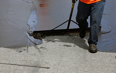 Denler Employee Sealcoating Pavement
